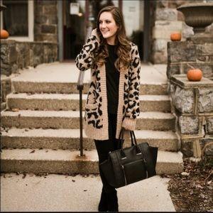 Hollister leopard sweater. NWOT